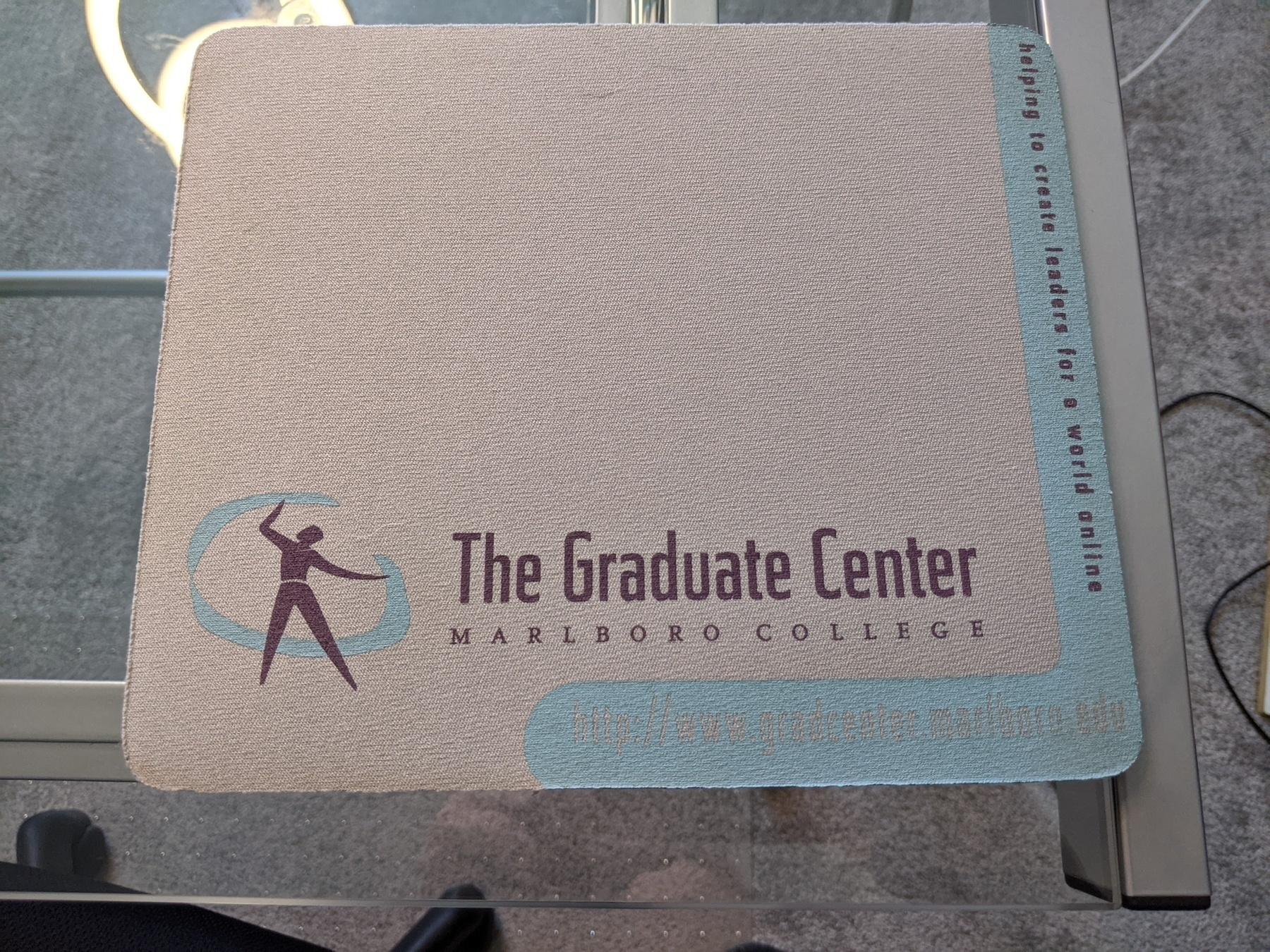 Mousepad that says Graduate Center at Marlboro College, helping to create leaders for a world online.
